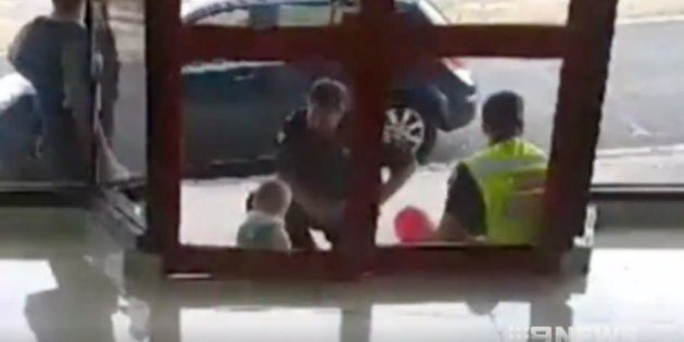 Police comforted the child after rescuing