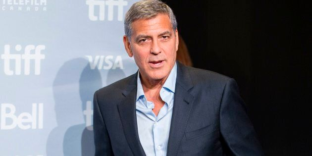George Clooney attending a photo call at the Toronto International Film Festival for his movie