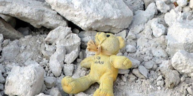 IDLIB, SYRIA - OCTOBER 24:  A toy lying on the wreckage of a building is seen after the war crafts belonging to the Syrian Army bombed the Qefr Teharim town of Idlib, Syria on October 24, 2016. (Photo by Mohammed Jbas/Anadolu Agency/Getty Images)