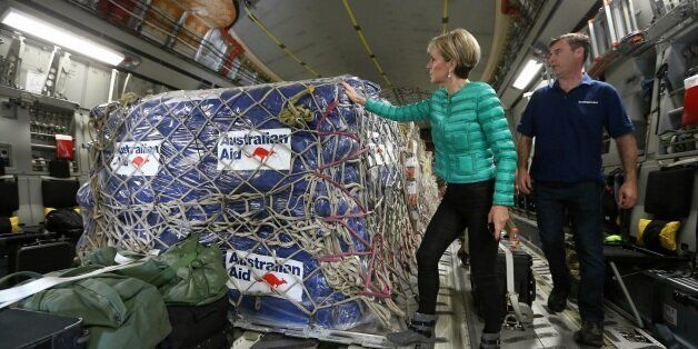 Minister for Foreign Affairs Julie Bishop inspects aid supplies on a RAAF plane bound for Fiji after...