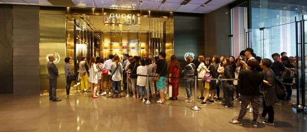 Customers line up for a Gucci store in