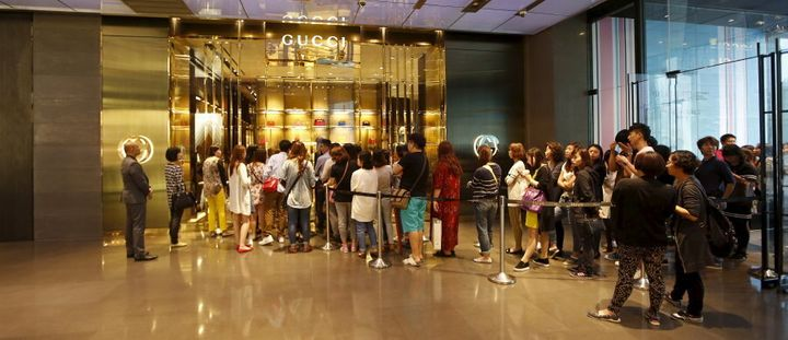 Customers line up for a Gucci store in Shanghai.