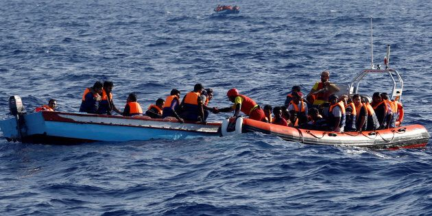 An inflatable boat from the Spanish vessel Astral operated by the NGO Proactiva collects migrants off the Libyan coast in the Mediterranean Sea August 18, 2016.  REUTERS/Giorgos Moutafis