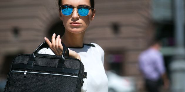 Cool accessories such as sunglasses can add a modern touch to corporate clothing.
