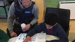 Off-Duty Cops Help Bridge Language-Divide For Kids From Migrant