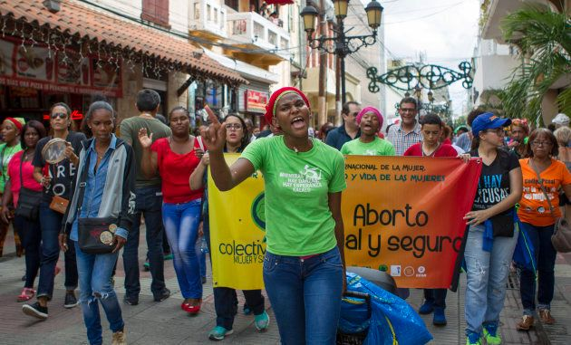 People take part in a march demanding the Dominican President not criminalise abortion in Santo Domingo...