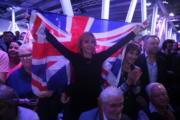 A Brexit supporter holds a Union Flag at a Vote Leave rally in London, Britain on June 4, 2016. Polls...