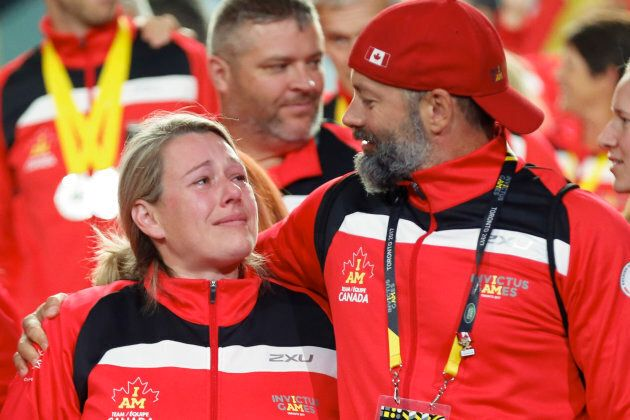 Canadian athletes get emotional as they enter the stage during the Invictus Games closing