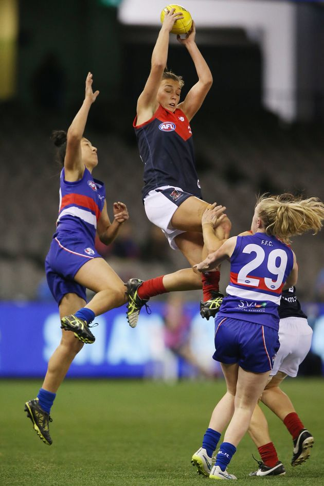 Ebony-Rose Antonio of the Demons takes a screamer during a Women's AFL exhibition match in