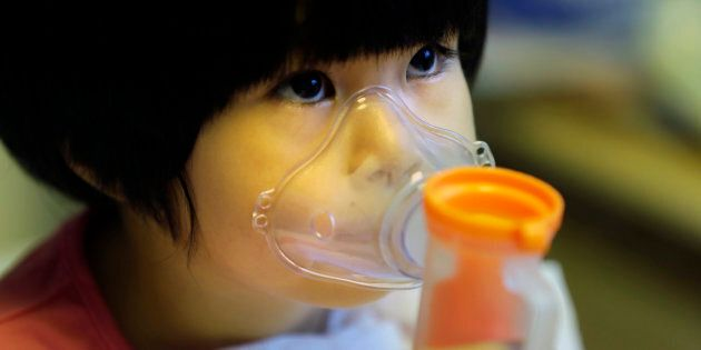 A two year old in Beijing receives nebuliser therapy during a pollution 'red alert' in