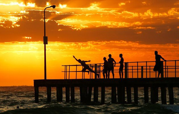 People dive into the sea from the pier at St Kilda beach on January 30, 2009 in Melbourne during a