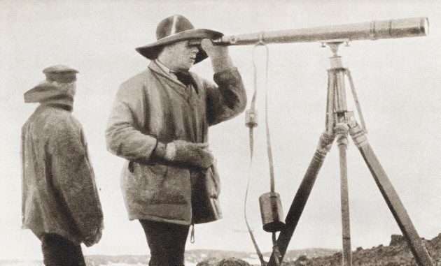 Robert Falcon Scott Looking Through A Telescope During The Terra Nova Expedition To The South Pole In