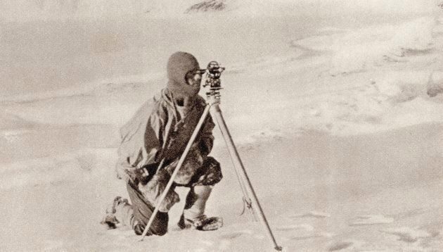 Evans -- pictured here observing with the Theodolite used by Captain Scott to fix the position of The...