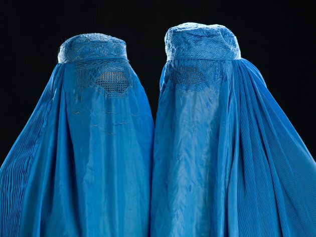 The burqa overs the entire face and body, leaving just a mesh screen to see