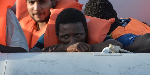 Men wait on a rubber boat to be rescued by the crew of the Topaz Responder ship run by Maltese NGO Moas and the Italian Red Cross during a rescue operation of Migrants and refugees on November 3, 2016, off the Libyan coast in the Mediterranean Sea. / AFP / ANDREAS SOLARO        (Photo credit should read ANDREAS SOLARO/AFP/Getty Images)