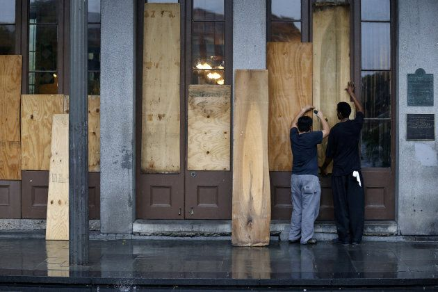 Business owners board up their restaurant in the French
