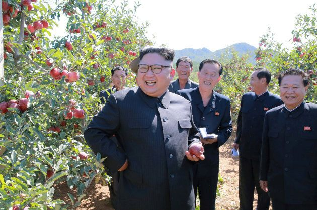 North Korean leader Kim Jong Un gives field guidance during a visit to a fruit orchard in Kwail