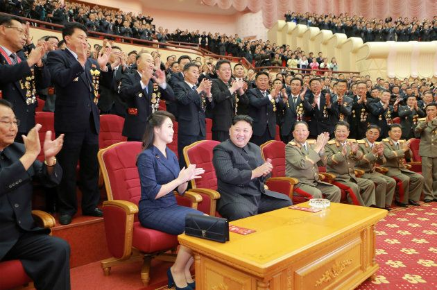 North Korean leader Kim Jong Un claps during a celebration for nuclear scientists and engineers.