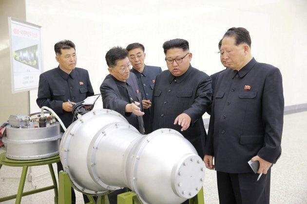 North Korean leader Kim Jong Un examines nuclear weapons