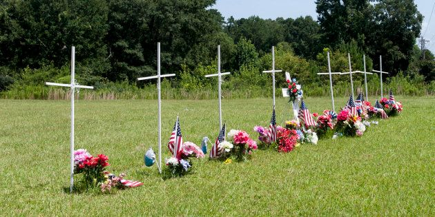 Eight white crosses were erected in memory of the victims in Mississippi.