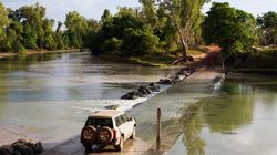 Massive Croc Stands Off Against Truck On Flooded Northern Territory