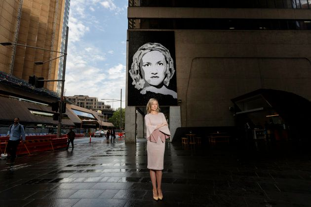 Domestic abuse advocate Felicity Cook is pictured in front of a new mural unveiled in Sydney on Monday.