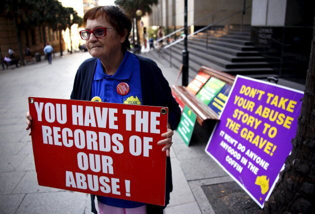 An abuse victim stands outside the venue for Australia's Royal Commission into Institutional Response...
