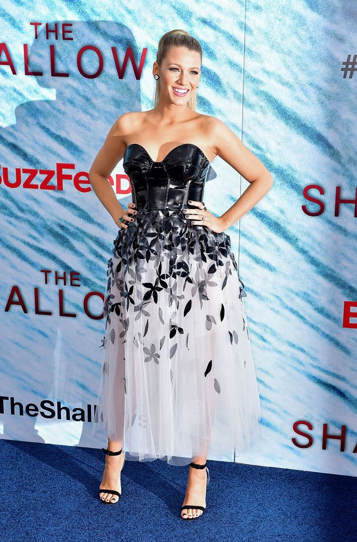 A day earlier she attended 'The Shallows' World Premiere in New York City. An S and M style latex bodice paired strangely but perfectly with a white tulle skirt with floral cutouts. It just works.