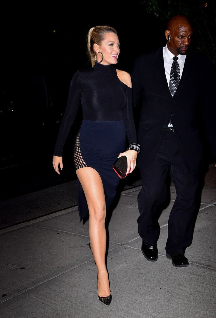 That same evening on the 21st Lively wore a black asymmetrical long sleeve bodysuit with a navy thigh high split skirt and classic black pumps.