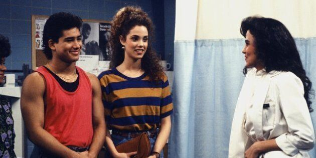 SAVED BY THE BELL -- 'From Nurse to Worse' Episode 16 -- Air Date 12/15/1990 -- Pictured: (l-r) Mario Lopez as A.C. Slater, Elizabeth Berkley as Jessie Spano, Nancy Valen as Jennifer -- Photo by: Gary Null/NBCU Photo Bank