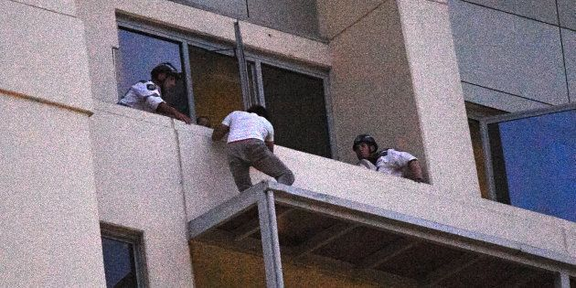 A man who spent the day on an awning on a high rise building in Chatswood gives himself up to Police...