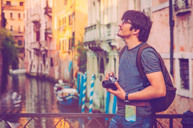 Young man travelling in Venice,