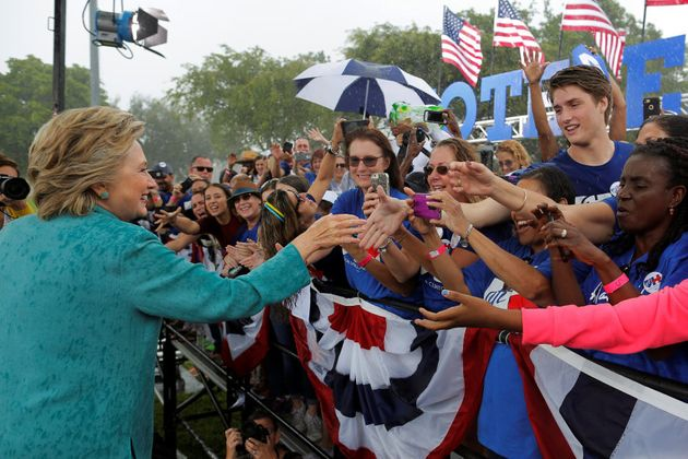 U.S. Democratic presidential nominee Hillary Clinton greets audience members at a campaign rally in the...