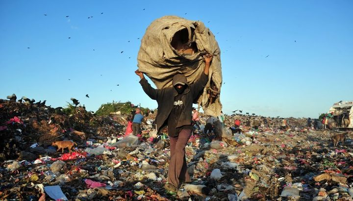 People collect plastics and metals to be sold for recycling, at Managua's landfill 'La Chureca'.