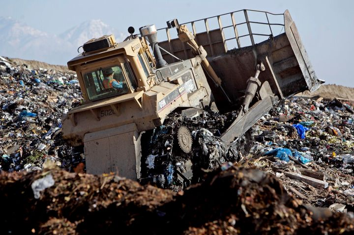A bulldozer churns through mounds of garbage at the Puente Hills Landfill facility. It is the biggest active landfill in the nation. Every day more than 13,000 tons of garbage is dumped there each year, nearly 4 million tons, about a third of LA County's trash.