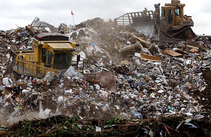 In California, U.S.A heavy equipment operators use machinery to compact and shape mountains of trash at L.A.