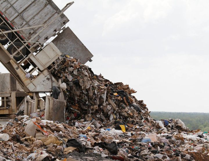 A tipper dumps a load of trash at the Shoosmith Landfill  in Chesterfield, Virginia, U.S.A.