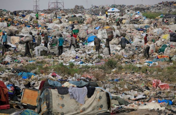 Scavengers in Lagos, Nigeria sort out iron and plastic to sell at the Olusosun dump site the city's largest dump.