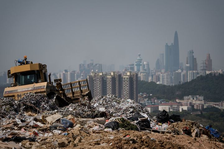 A landfill in the new territories of Hong Kong with the Chinese city of Shenzhen looms in the background.