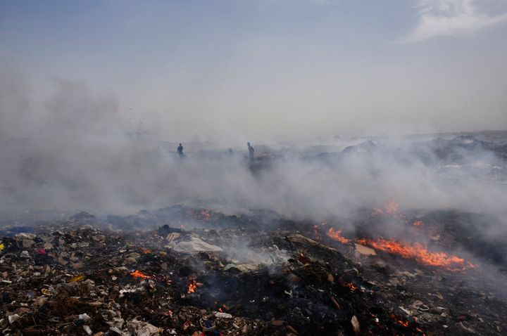 Smoke rising out of fire at Delhi's largest landfill, Bhalswa dump yard, due to soaring temperature in New Delhi, India.