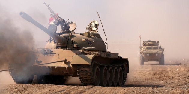 Military vehicles of Kurdish peshmerga forces roll towards
