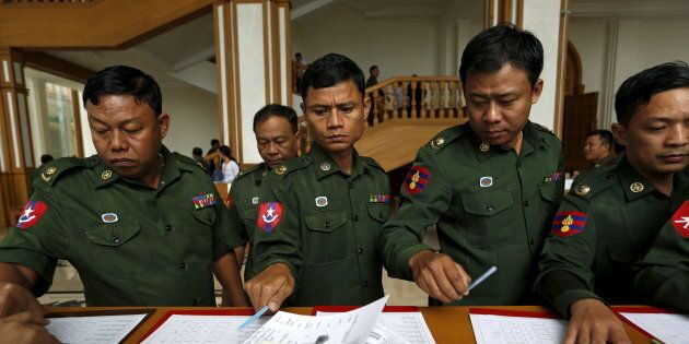 Myanmar's army members of the parliament arrive at the Union Parliament session in Naypyitaw January...