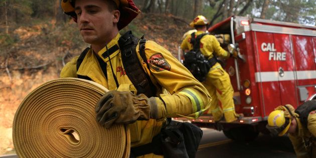 Firefighters work to contain a wildfire outside Calistoga, California,