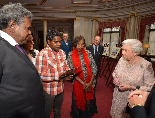 Queen Elizabeth II and the Duke of Edinburgh talk with Kevin Namajtira (left) the grandson and Lenie Namatjira (centre) the granddaughter of Albert Namajtira.