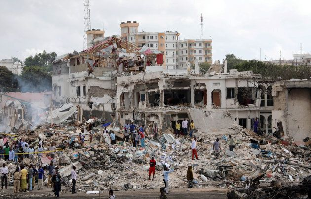 Somali government forces and civilians gather at the scene of an explosion in KM4 street in the Hodan district of Mogadishu, Somalia October 15, 2017.