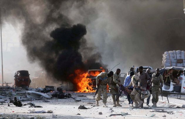 Somali Armed Forces evacuate their injured colleague, from the scene of an explosion in KM4 street in the Hodan district of Mogadishu, Somalia October 14, 2017.