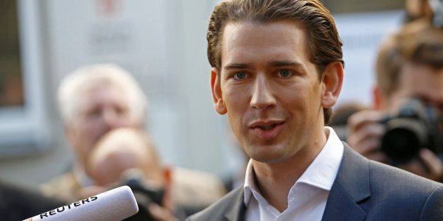 Top candidate of Peoples Party (OeVP) and Foreign Minister Sebastian Kurz talks with journalists after...