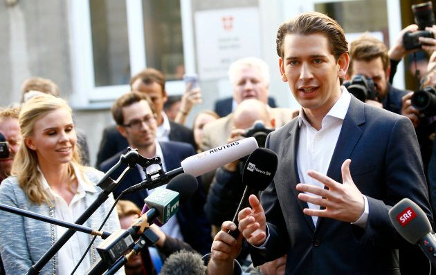 Top candidate of Peoples Party (OeVP) and Foreign Minister Sebastian Kurz talks with journalist after...