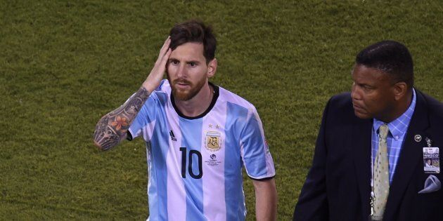 Argentina's Lionel Messi leaves the field after being defeated by Chile in the penalty shoot-out of the...