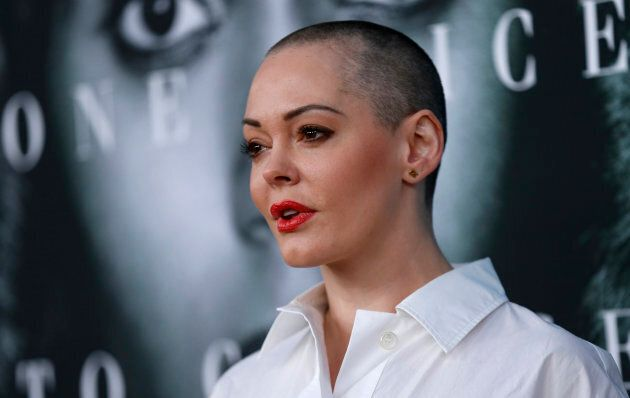 """Actress Rose McGowan poses at the premiere for the television movie """"Confirmation"""" in Los Angeles, California March 31, 2016."""